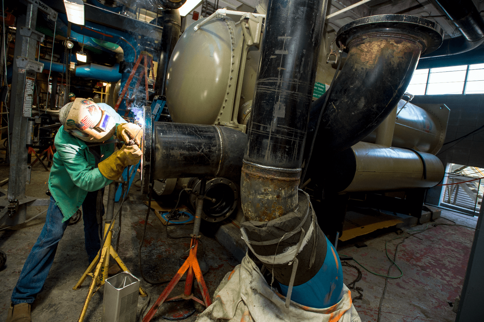 A welder working on pipes