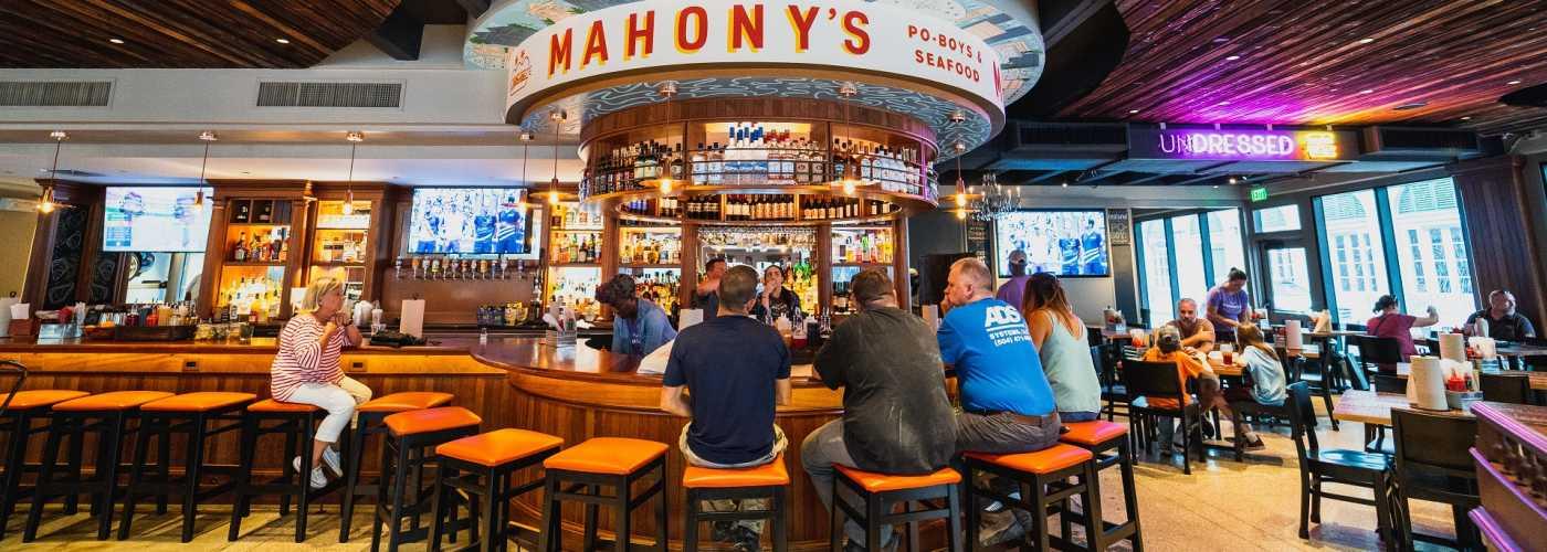 Patrons seated at bar at Mahony's Restaurant