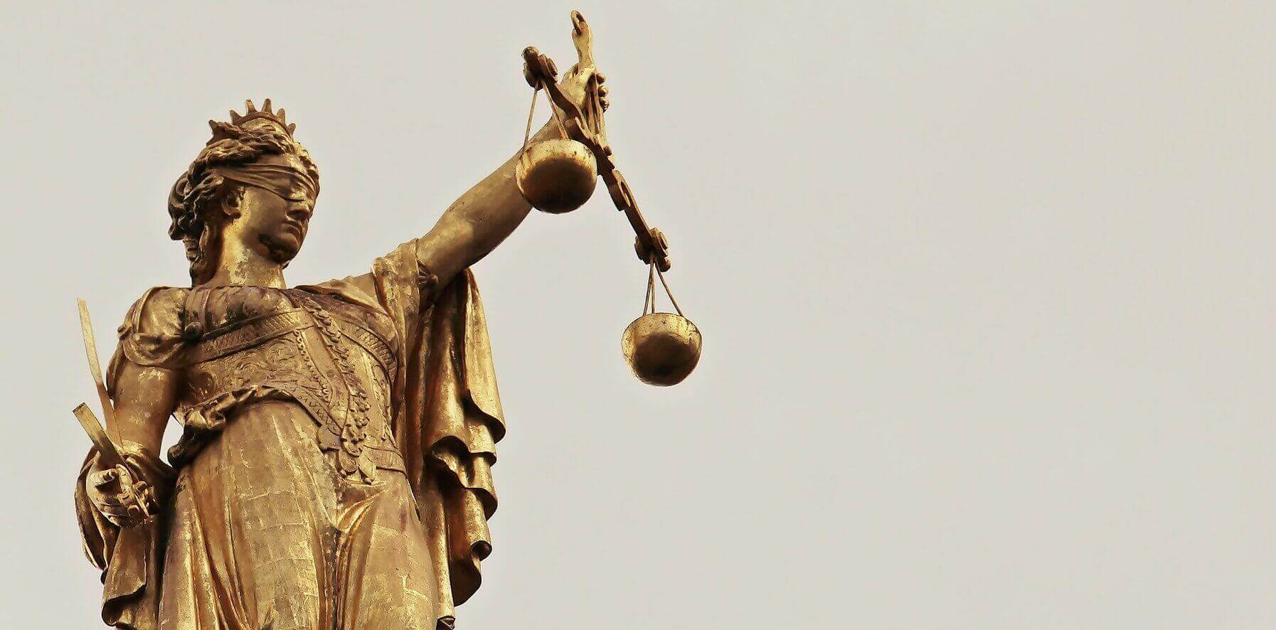 A statue of lady justice holding the scales of justice